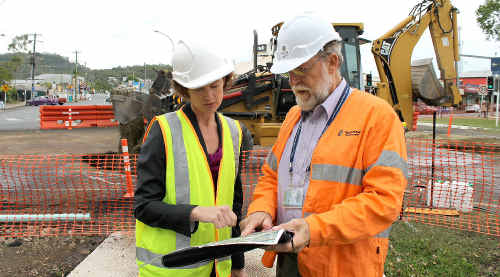 Member for Capricornia Kirsten Livermore and Department of Transport and Main Roads Mackay-Whitsunday regional director Ian Husband check the progress of work on the Bruce Hwy near Sarina.