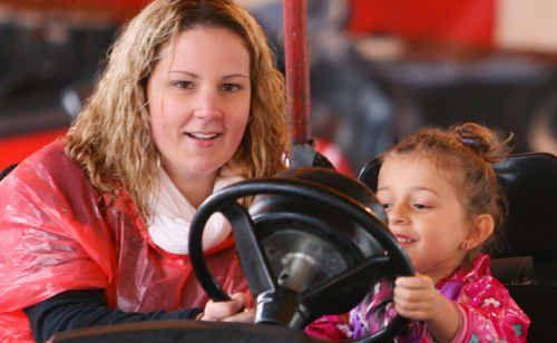 Kathryn Wozniak and her niece Laylanie Willie enjoy a ride on the dodgem cars at the Yeppoon Show.