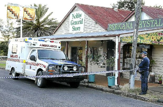 Police and ambulance crews attend the Nobby General Store after a local man was shot yesterday.