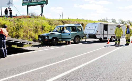 A Land Rover Discovery is towed from the accident scene yesterday.