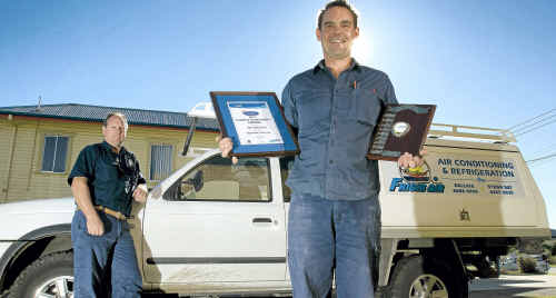 Tim Whitehead (front) and his boss Ted Slattery, from local air-conditioning and refrigeration company Frigid-Air, is TAFE's Far North Coast Apprentice of the Year. Jay Cronan