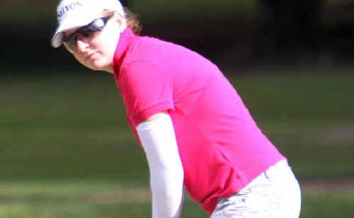 Jennifer Ray chips to win the North Queensland Women's Open title at Mackay Golf Club yesterday.