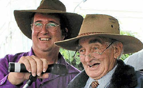 Deputy Mayor Peter Blundell learns from the master, Peter Bondfield, announcing at the Apple and Grape Festival.