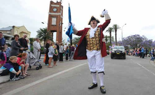 Trevor Green, in full cry at the Jacaranda Parade on Saturday, will be competing in the Town Crier Nationals in July.