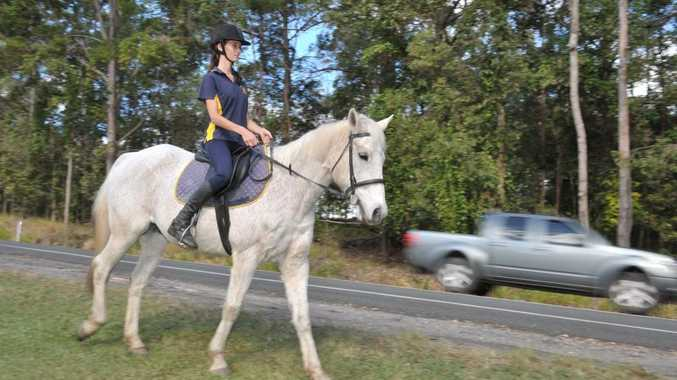 Pomona Pony Club member Johanna Lister-Smith says some motorists abuse her when she rides her horse, Andy, next to the road.