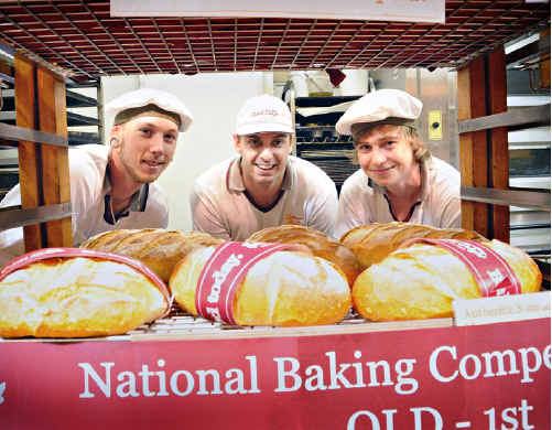 Bakers Delight Gympie manager Luke Callaghan (centre) with his award-winning baking team, Dean Schlomm and Cameron Moore.