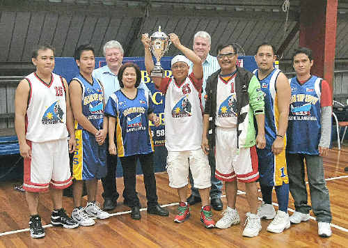 Inaugural Filipino Basketball League champions Chilsan accept the premiership trophy from LNP Member for Flynn Ken O'Dowd (back left) and Gladstone Multicultural Association Inc President Cr Craig Butler. Chilsan manager and sponsor Violy Romero accepted the trophy.