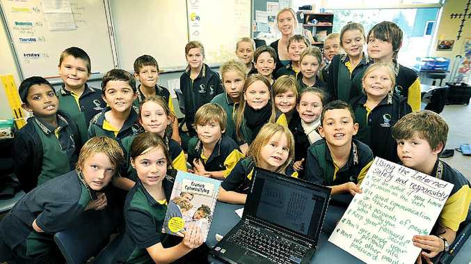 CYBER BULLYING: Year 3 Xavier Catholic college students with the computer program held by Olivia Welch.