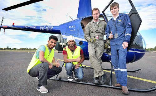 Royal Oman Police Force air wing students Ali Mashayakh, Mohammed Al Qadhi with Chopperline graduates Mitchell McFarland and Jamie Hall at Maryborough airport.