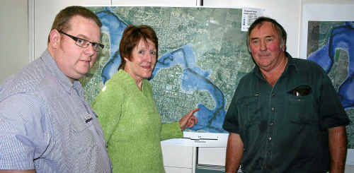 Southern Downs Regional Council design and assets manager Adam Colrain with Lynda and Gerry Hemmings at the flood meeting.