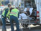 A man is treated by paramedics following a crash at the corner of Beach Rd and Islander Rd.