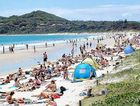 Main Beach at Byron Bay packed with visitors – the powerful dollar has made the Northern Rivers less attractive to overseas tourists.
