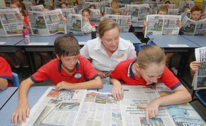 APNs NIE Writer Robyn Courtney with St Francis Xavier School Captains Riley Head and Georgia Worbey