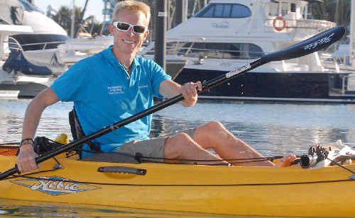 Queensland Tourism Ambassador Ben Southall arrives at Mackay Marina by kayak yesterday.