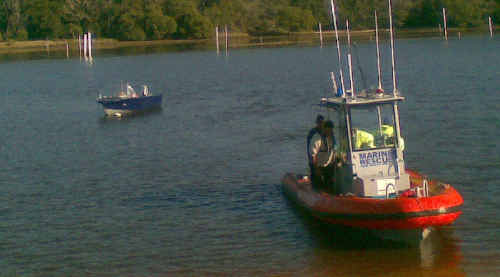 Marine Rescue Wooli tows a vessel back to shore after it became stranded near Wooli.