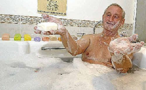 Keith Ainsworth of Soap Creations and Body Care in his 'testing station' in his Eltham home.