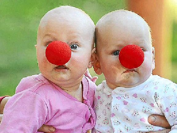Sydney twins Ellenore (left) and Tegan Hunt show support for Red Nose Day, when thousands will raise funds for Sudden Infant Death Syndrome (SIDS) medical research, and Kids, which has helped save the lives of more than 7000 babies.