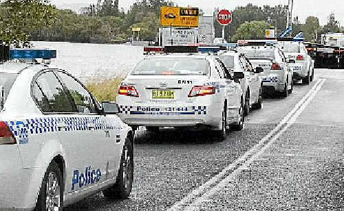 Police at Burns Point Ferry following reports of a man with a firearm.