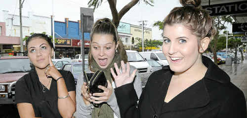 Koryn Barrett, of Lennox Head, Rebecca Browne, of Ballina, and Lucy Edwards, of Ballina contemplate what they would complain about if Ballina Shire Council introduced a new system that would provide random chance of receiving $100 cash reward to people who make complaints about services or maintenance issues.