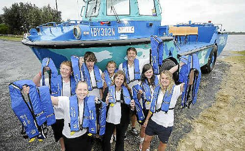 Ballina High School Marine Discovery Centre co-ordinator Lynda Hourigan (front centre) and her students with some of the 100 new life-jackets donated by NSW Maritime.