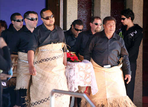 Mourners including Joel Namoa's younger brother Nick Namoa, front left, carrying his coffin from St Joseph's Church.