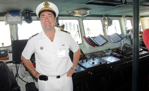 Skipper on the French Navy boat in Mackay Joseph Couval on the bridge.