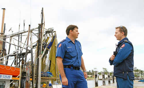 Yamba Paramedics Gavin Bridges (left) and Adam Jarrett debrief after taking 13-year-old Drew Hall to hospital following a collision with a whale near Brooms Head.