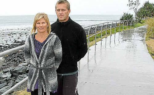 """Lennox Head residents Heather and David Walker are amongst many locals who believe the new handrail on the pathway near Lennox Point is """"excessive"""" and out of character with the environment."""