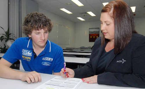 Bryan Reitano gains some assistance from the operations manager for Ace Apprenticeships, Sasha Carter.