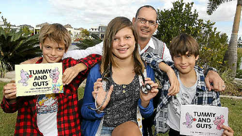 Pelican Waters Doctor Nick Dreyer and his 11-year-old daughter Jessica have penned a book on health for children called Tummy and Guts. Nine-year-old twins Niclas and Dante also helped with the project.