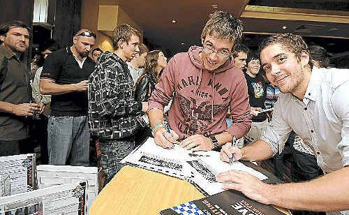 Stephen Duncan (left), of Casino, and Michael Pirlo, of Lismore, fill out application forms at yesterday's Queensland Police recruitment day in Lismore.