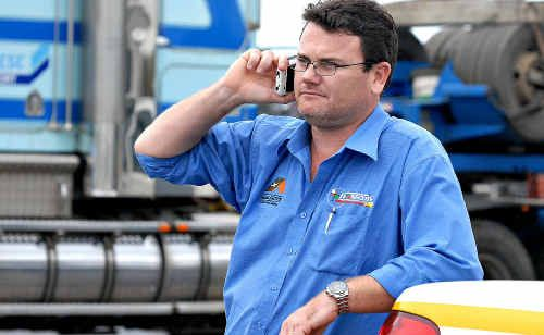 Todd Gavan, at work at Transcote in Mackay, has been nominated for an award for overcoming major arm injuries to return to work.