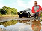 Josh Briggs examines a pothole on the drive into Dreamtime Beach Car Park at Fingal Head.
