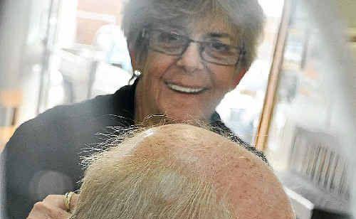 Popular barber Eileen Rose with Bill Hunneman.