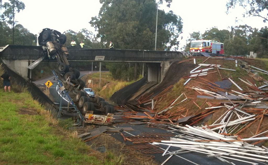 A truck has crashed on the Gympie Road overpass at Tinana.