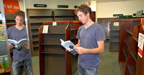 Aaron Caelli of Ingham was at Angus and Robertson store Mackay in search of a bargain.