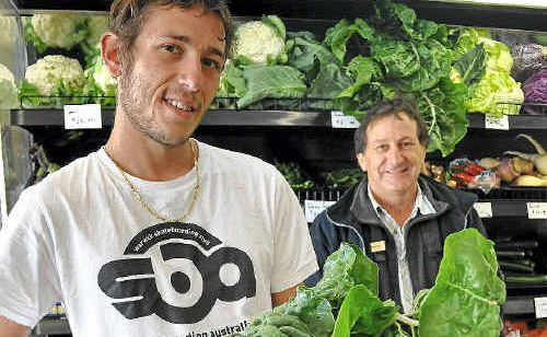 Michael Puglisi, with father Percy, stock and sell local produce.