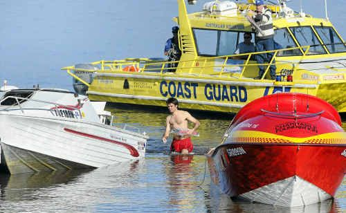 The Ballina coast guard, Ballina Surf Live Saving Club inflatable and Ballina marine jetboat joined forces to rescue two fishermen after their boat capsised crossing the Ballina bar.