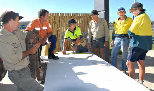 Passing down their experience to school-based apprentice Lachlan Anderson, centre, at Mackay's stadium site are, from left, Gary Ferry, Mick Johnson, Mark Swanton, Mervyn Barber and Tyler Clein.