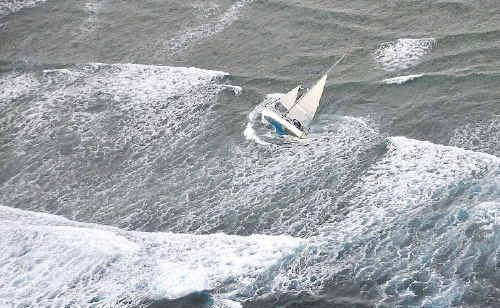 A couple were winched to safety from their yacht by a RACQ Capricorn helicopter.