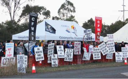 More than 300 workers waved signs at the union protest line near Moranbah on Wednesday morning.