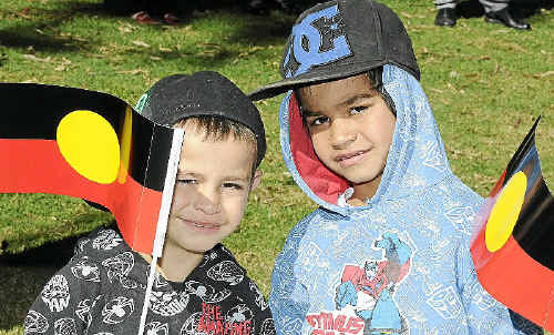 Darnell (left) and Deshaun Blades celebrate NAIDOC Week at the flag raising ceremony at Picnic Point yesterday.