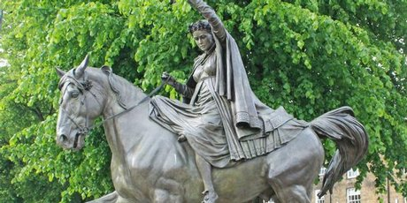 Statue of a fine lady upon a white horse at Banbury Cross, Oxfordshire.