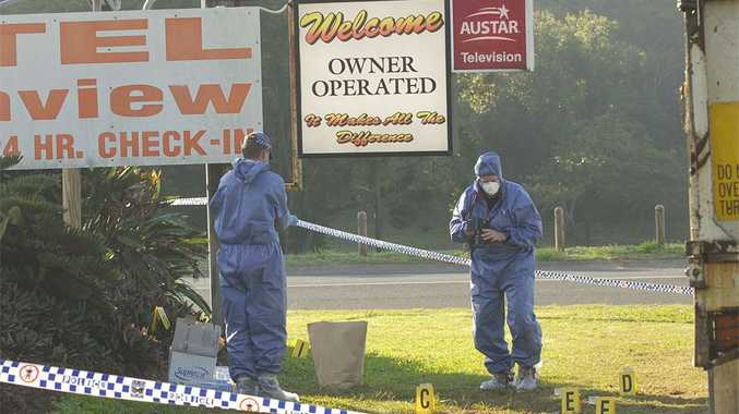 Forensic officers comb the area near the Northview Motel in Phillip St, Mt Pleasant, after a 41-year-old man allegedly was stabbed several times in the chest.