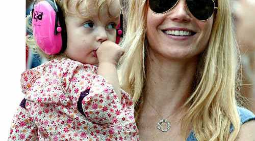SCRUMPTIOUS: US actress Gwyneth Paltrow, holding her daughter Apple at a Coldplay concert in 2005.