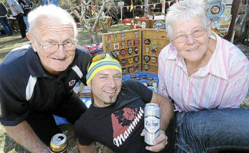 Warwick and Gwen Shinner enjoy a cold beer with (centre) Philipp Brull of Austria at the Swamparama in Pimlico.