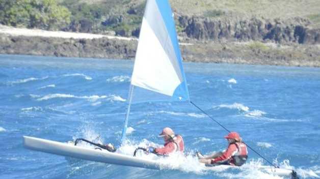 Ben Southall (left) and Jessica Watson kayak around the Whitsundays.