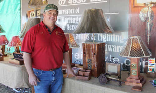 Dan Dray shows off some of his antique lamps at Ag-Grow.