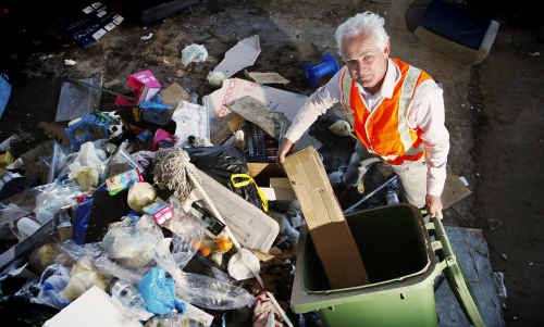 Councillor Trevor Nardi deposits rubbish at the Riverview recycling and refuse centre.