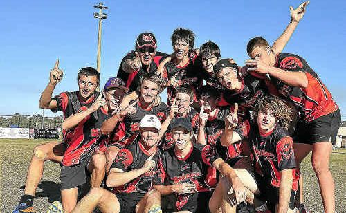 Rockhampton under-18 boys celebrate their State Cup win over BMTA/First Contact in Hervey Bay on Sunday afternoon.